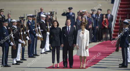 British Prime Minister David Cameron Samantha Cameron His Wife and Us Chief of Protocol Capricia Marshall (r) Listen to the British National Anthem After Stepping Off Their Plane at Andrews Air Force Base Usa 13 March 2012 Reports State That David Cameron is in Washington For a Three-day Visit For Talks with Us President Barack Obama and with the Situation in Afghanistan High on Their Agenda Cameron Will Join Us President Barak Obama This Evening at a Ncaa Basketball Playoff Game in Dayton Ohio United States