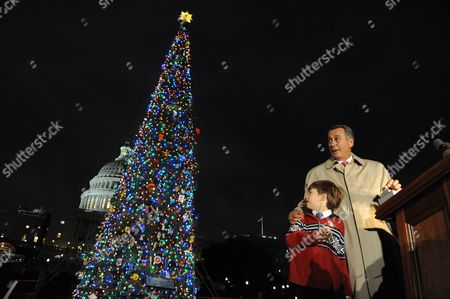 Us Speaker of the House John Boehner (r) and a 7-year-old Home Schooled Student From Sonora California Johnny Crawford (l) Light the Capitol Christmas Tree During a Ceremony on the West Front of Capitol Hill in Washington Dc Usa 06 December 2011 This Year's Tree Comes From California United States Washington