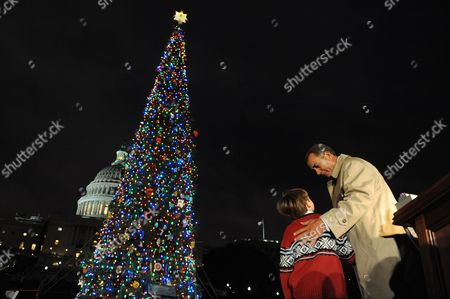 Us Speaker of the House John Boehner (r) and a 7-year-old Home Schooled Student From Sonora California Johnny Crawford (l) Look at the Capitol Christmas Tree After Lighting It During a Ceremony on Capitol Hill in Washington Dc Usa 06 December 2011 This Year's Tree Comes From California United States Washington