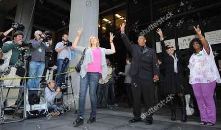 Fans of the Late Singer Michael Jackson Including Eddie Jones (3r) President of the Los Angeles Civil Rights Association Hold Up Four Fingers For the Number of Years That Dr Conrad Murray who was Convicted of Involuntary Manslaughter For the Death of Pop Singing Legend Michael Jackson was Sentenced to in Los Angeles California Usa 29 November 2011 United States Los Angeles