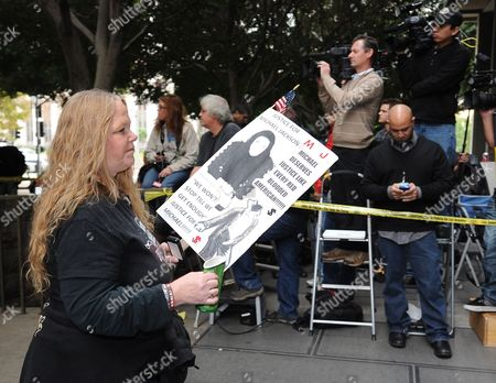 A Michael Jackson Fan Carries a Placard Outside the Courthouse where the Sentencing of Dr Conrad Murray who was Convicted of Involuntary Manslaughter For the Death of Pop Singing Legend Michael Jackson Will Take Place at the Los Angeles Superior Courthouse in Los Angeles California Usa 29 November 2011 Murray Faces Up to Four Years of Jail Time in the Death of Michael Jackson United States Los Angeles