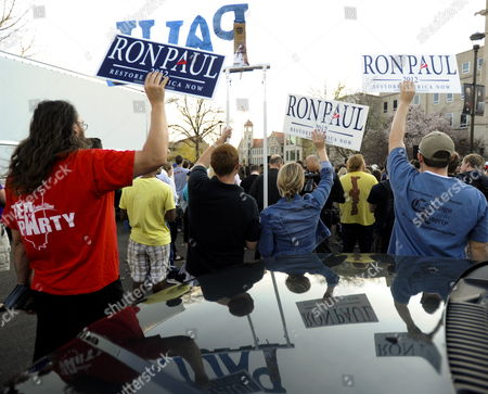 Supporters of Republican Presidential Candidate Ron Paul Hold Signs and Are Reflected in the Hood of a Truck As Republican Presidential Candidate and Former Massachusetts Governor Mitt Romney Speaks at a Town Hall Meeting Outside of Bradley Hall at Bradley University in Peoria Illinois Usa 19 March 2012 the Illinois Republican Primary is the Next Test the Candidates Face and Will Be Held 20 March 2012 United States Peoria