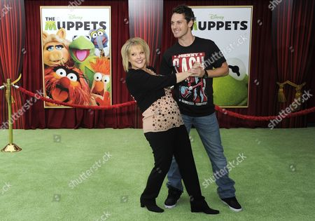 Us Television Personality Nancy Grace (l) and Tristan Macmanus (r) Arrive For the World Premiere of 'The Muppets' in Los Angeles California Usa 12 November 2011 United States Los Angeles