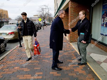 Stock Picture of Fred Karger (l) Political Consultant Gay Rights Activists and the First Openly Gay Presidential Candidate From a Major Political Party (republican) in American History Shakes the Hand of a Voter (r) on Main Street While Campaigning in Nashua New Hampshire Usa 05 January 2012 He Previously Served As a Senior Consultant to the Campaigns of Presidents Reagan George H W Bush and Gerald Ford He Officially Annunced His Candidacy on March 23 2011 on Left is Campaign Staff Member Kevin Miniter Using His Mobile Phone United States Nashua