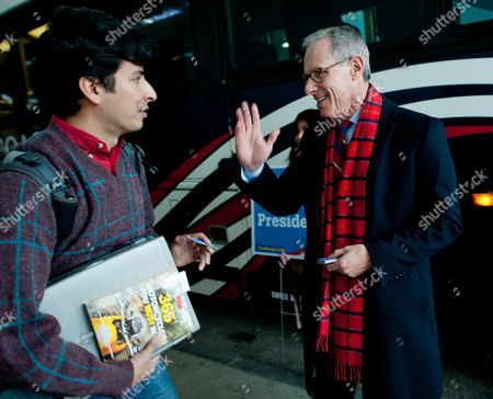 Fred Karger (right) Political Consultant Gay Rights Activists and the First Openly Gay Presidential Candidate From a Major Political Party (republican) in American History Greets a Commuter at the Bus Terminal in Manchester New Hampshire Usa 05 January 2012 He Previously Served As a Senior Consultant to the Campaigns of Presidents Reagan George H W Bush and Gerald Ford He Officially Announced His Candidacy on March 23 2011 United States Nashua