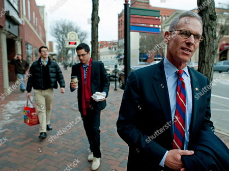 Stock Image of Obscure Republican Candidate For United States President Fred Karger (r) Along with Members of His Campaign Kevin Miniter (l) and James Baer (c) Walks Along Main Street Introducing Himself to Voters in Nashua New Hampshire Usa 05 January 2012 Fred Karger of California Announced His Candidacy For United States President in March of 2011 and Has Been Campaigning in New Hampshire Ever Since a Former Senior Consultant on Campaigns For Presidents Ronald Reagan George H W Bush and Gerald Ford Karger Says His 35 Years of Experience in Politics 'Inspired Me to Run ' Although He Has not Been Included in the Televised Presidential Debates He Has Campaigned Heavily by Purchasing Television Advertising and in Person Knocking on Doors and Visiting Establishments an Advocate For Gay Rights Karger is the First Openly Gay Candidate For United States President the Requirements to Be on the New Hampshire Ballot Are That You Need to Be a a United States Citizen at Least 35-years-of-age by Time You Take Office File the Appropriate Forms and Pay a Fee of $1000 to the State of New Hampshire United States Nashua