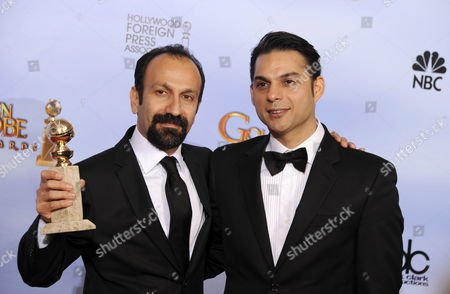Iranian Director Asghar Farhadi (l) and Actor Peyman Moaadi (r) Pose with the Golden Globe Award For Best Foreign Language Film For 'A Separation' (iran) in the Press Room at the 69th Golden Globe Awards Held at the Beverly Hilton Hotel in Beverly Hills Los Angeles California Usa 15 January 2012 United States Beverly Hills