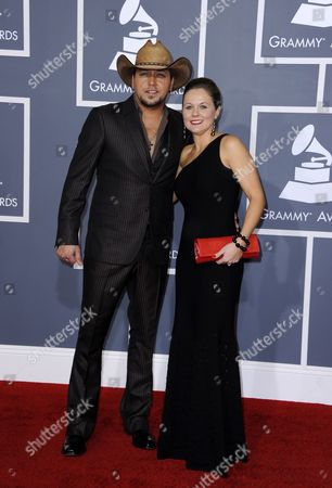 Singer Jason Aldean (l) and Jessica Aldean Arrive For the 54th Annual Grammy Awards at the Staples Center in Los Angeles California Usa 12 February 2012 United States Los Angeles