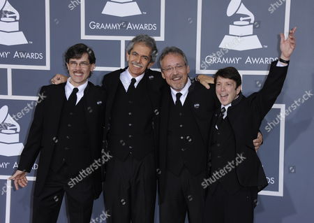 Stock Image of Vocalist Dennis Scott (l-to-r) David Toledo Bryan Cumming and Nathan Burbank Arrive For the 54th Annual Grammy Awards at the Staples Center in Los Angeles California Usa 12 February 2012 United States Los Angeles