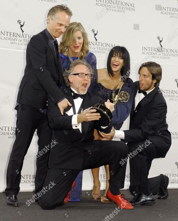 Producers Soren Staermose (3-l) and Susann Billberg Rydholm (2-l) of Sweden Pose with Actress Jessica Szohr (2-r) of the United States and Actor Vladimir Brichta (r) of Brazil After Winning an Emmy For 'Millennium' in the Tv Movie/mini-series Category at the 39th International Emmy Awards Held at the Hilton Hotel in New York New York Usa 21 November 2011 the Man at Left is Unidentified United States New York