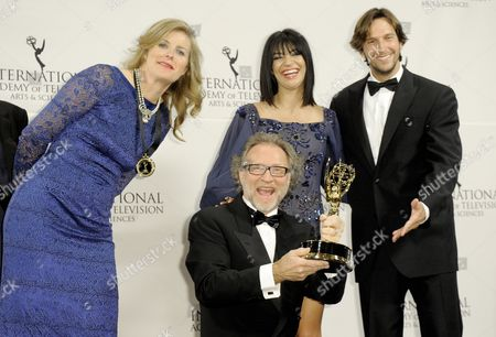 Producers Soren Staermose (2-l) and Susann Billberg Rydholm (l) of Sweden Pose with Actress Jessica Szohr (2-r) of the United States and Actor Vladimir Brichta (r) of Brazil After Winning an Emmy For 'Millennium' in the Tv Movie/mini-series Category at the 39th International Emmy Awards Held at the Hilton Hotel in New York New York Usa 21 November 2011 United States New York