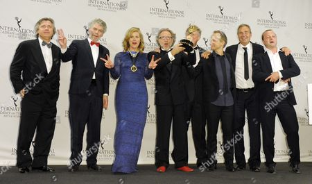 Producers Susann Billberg Rydholm (3-l) Soren Staermose (4-l) and Group of Other Collaborators of Sweden Pose in the Press Room After Winning an Emmy For 'Millennium' in the Tv Movie/mini-series Category at the 39th International Emmy Awards Held at the Hilton Hotel in New York New York Usa 21 November 2011 United States New York