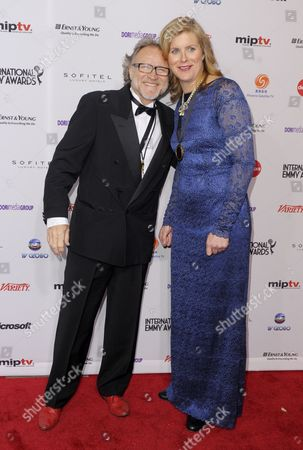 Producers Soren Staermose (l) and Susann Billberg Rydholm of Sweden and Nominated For 'Millennium' in the Tv Movie/mini-series Category Arrive For the 39th International Emmy Awards Held at the Hilton Hotel in New York New York Usa 21 November 2011 United States New York