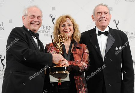 Producers John Kastner (l) and Silva Basmajian (c) of Canada Appear with Television Journalist Dan Rather (r) in the Press Room After Winning an Emmy For 'Life with Murder' in the Documentary Category at the 39th International Emmy Awards Held at the Hilton Hotel in New York New York Usa 21 November 2011 United States New York