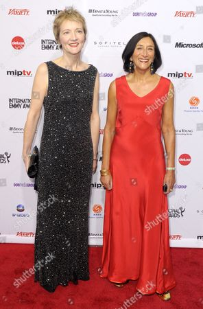 Stock Image of Producers Roxy Spencer (l) and Sita Williams of the United Kingdom and Nominated For 'Accused' in the Drama Series Category Arrives For the 39th International Emmy Awards Held at the Hilton Hotel in New York New York Usa 21 November 2011 United States New York