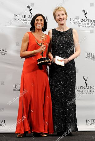 Stock Picture of Producers Sita Williams (l) and Roxy Spencer of the United Kingdom Pose in the Press Room After Winning an Emmy For 'Accused' in the Drama Series Category at the 39th International Emmy Awards Held at the Hilton Hotel in New York New York Usa 21 November 2011 United States New York