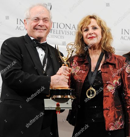 Producers Silva Basmajian (r) and John Kastner of Canada Appear in the Press Room After Winning an Emmy For 'Life with Murder' in the Documentary Category at the 39th International Emmy Awards Held at the Hilton Hotel in New York New York Usa 21 November 2011 United States New York
