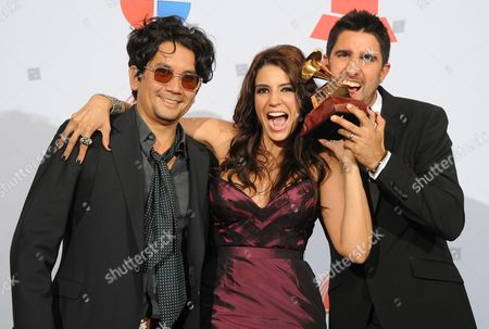 Members of Group Alex Jorge Y Lena (l-r): Colombian Jorge Villamizar Cuban Lena Burke and Spanish Alex Ubago Celebrate Their Latin Grammy For Best Group During the 12th Annual Latin Grammy Awards in Las Vegas Nevada Usa 10 November 2011 Latin Grammy Awards Recognize Artistic And/or Technical Achievement not Sales Figures Or Chart Positions and the Winners Are Determined by the Votes of Their Peers-the Qualified Voting Members of the Academy United States Las Vegas