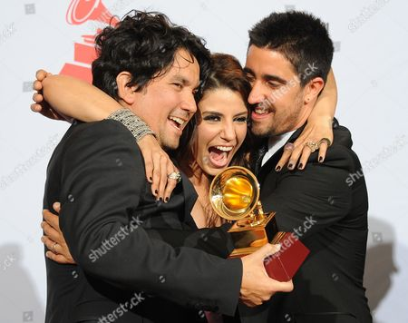 Members of Group Alex Jorge Y Lena(l-r): Colombian Jorge Villamizar Cuban Lena Burke and Spanish Alex Ubago Celebrate Their Latin Grammy For Best Group During the 12th Annual Latin Grammy Awards in Las Vegas Nevada Usa 10 November 2011 Latin Grammy Awards Recognize Artistic And/or Technical Achievement not Sales Figures Or Chart Positions and the Winners Are Determined by the Votes of Their Peers-the Qualified Voting Members of the Academy United States Las Vegas