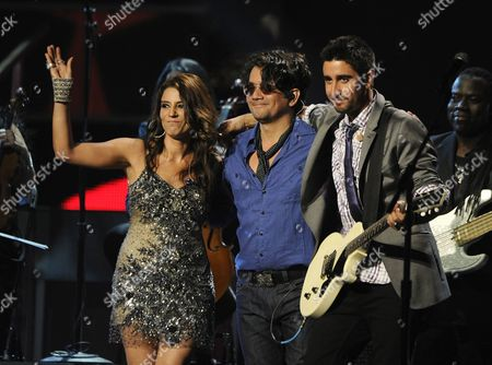 Stock Image of Members of Group Alex Jorge Y Lena(l-r): Cuban Lena Burke Colombian Jorge Villamizar and Spanish Alex Ubago Perform During the 12th Annual Latin Grammy Awards in Las Vegas Nevada Usa 10 November 2011 Latin Grammy Awards Recognize Artistic And/or Technical Achievement not Sales Figures Or Chart Positions and the Winners Are Determined by the Votes of Their Peers-the Qualified Voting Members of the Academy United States Las Vegas