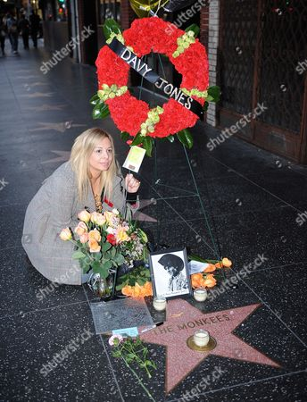 A Fan Poses Next to Flowers Photos and Inscriptions That Have Been Placed For British Singer-songwriter Davy Jones on the Star For the Rock Group Monkees in Hollywood California Usa 29 February 2012 in Memory of Jones who Passed Away 29 February 2012 United States Hollywood