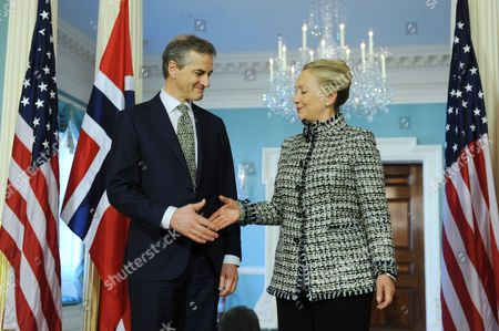 Us Secretary of State Hillary Clinton (r) Shakes Hands with Norwegian Foreign Minister Jonas Gahr Stoere (l) Before Their Bilateral Meeting at the State Department in Washington Dc Usa 10 January 2012 United States Washington
