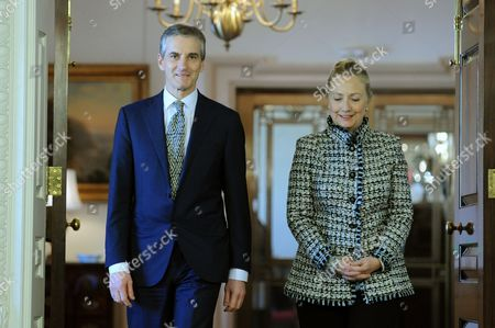Us Secretary of State Hillary Clinton (r) and Norwegian Foreign Minister Jonas Gahr Stoere (l) Walk Together Before Their Bilateral Meeting at the State Department in Washington Dc Usa 10 January 2012 United States Washington