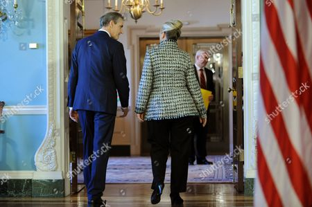 Us Secretary of State Hillary Clinton (r) and Norwegian Foreign Minister Jonas Gahr Stoere (l) Walk Away After Delivering Remarks to Members of the News Media Before Their Bilateral Meeting at the State Department in Washington Dc Usa 10 January 2012 United States Washington