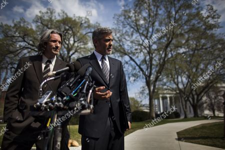 Us Actor George Clooney (c) and Enough Project's John Prendergast (l) Chat with the Media After Speaking with President Obama About the Situation in Darfur at the White House in Washington Dc Usa 15 March 2012 United States Washington