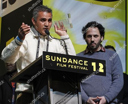 Palestine Director Emad Burnat (l) and Israeli Activist Director Guy Davidi (r) Accept the World Cinema Directing Award: Documentary For the Film '5 Broken Cameras' at the Sundance Film Festival Award Ceremony in Park City Utah Usa 28 January 2012 United States Park City