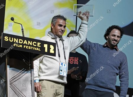 Directors Emad Burnat (l) and Guy Davidi (r) Accepts the World Cinema Directing Award: Documentary For the Film '5 Broken Cameras' at the Sundance Film Festival Award Ceremony in Park City Utah Usa 28 January 2012 United States Park City