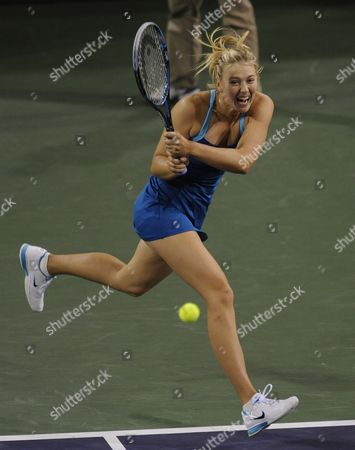 Maria Sharapova of Russia Follows Through with a Return Against Gisela Dulko of Argentina During the Bnp Paribas Open Tennis in Indian Wells California Usa 10 March 2012 United States Indian Wells