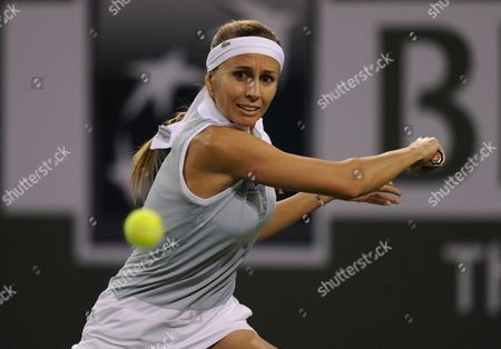Gisela Dulko of Argentina Sets Up For a Return Against Maria Sharapova of Russia During the Bnp Paribas Open Tennis in Indian Wells California Usa 10 March 2012 United States Indian Wells