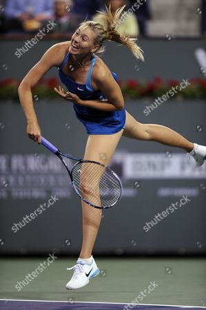 Maria Sharapova of Russia Follows Through with a Serve Against Gisela Dulko of Argentina During the Bnp Paribas Open Tennis in Indian Wells California Usa 10 March 2012 United States Indian Wells