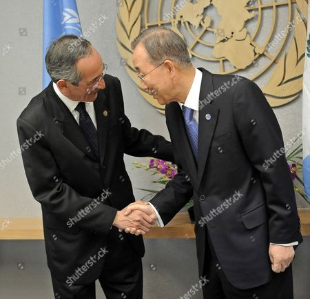 Alvaro Colom Caballeros (l) President of Guatemala Shakes Hands with United Nations Secretary-general Ban Ki-moon at the Start of a Meeting at United Nations Headquarters in New York New York Usa on 19 December 2011 United States New York