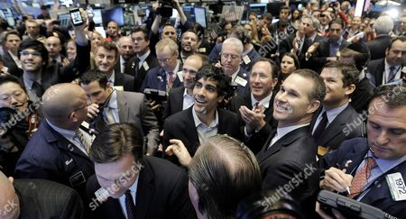 Jeremy Stoppelman (c) the Chief Executive Officer of Yelp Stands with Traders During His Company's Initial Public Offering on the Floor of the New York Stock Exchange Before the Closing Bell in New York New York Usa on 02 March 2012 Shares of the Company Were Up 66% in the First Hour of Trading United States New York