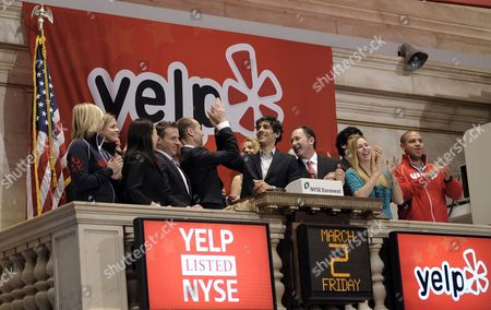 Jeremy Stoppelman (4-r) the Ceo of Yelp Celebrates While Ringing the Opening Bell with Employees During His Company's Initial Public Offering at the New York Stock Exchange in New York New York Usa on 02 March 2012 Shares of the Company Were Up 66% in the First Hour of Trading United States New York