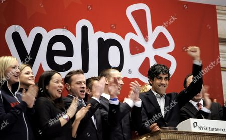 Jeremy Stoppelman (2-r) the Chief Executive Offucer of Yelp Celebrates While Ringing the Opening Bell with Employees During His Company's Initial Public Offering at the New York Stock Exchange in New York New York Usa on 02 March 2012 Shares of the Company Were Up 66% in the First Hour of Trading United States New York