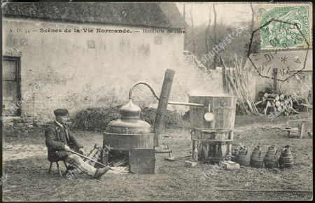 A Local Yokel Sits Beside Calvados Distillation Equipment On A Normandy Farm 1910