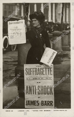 London Life - A Rotary Postcard Photograph Showing A Suffragette Selling Copies of 'The Suffragette Paper - October 1912 the Woman in the Image is Wearing A æholloway BroochÆ A æbrooch of HonourÆ Designed by Sylvia Pankhurst For Women Who Had Been Imprisoned in Holloway Prison the Brooch Shows ôa Portcullis Symbol of the House of Commons the Gate and Hanging Chains in Silver and the Superimposed Broad Arrow in Purple White and Green Enamelô the Newsletter æthe SuffragetteÆ Was Published by the WomenÆs Social and Political Union (wspu) It Replaced the Earlier ævotes For WomenÆ Newsletter in 1912 When the Wspu Became More Militant the Issue Which is On Display in the Photograph May Concern an Important Letter by Written by James Barr to the Prison Commissioners (right) in Which He Describes the Force-feeding of Rose Howey in Walton Prison Liverpool in January 1910 Prior to This Letter the Official Position On Force-feeding Was That It Was Done in Order to Save Lives However BarrÆs Letter Makes It Clear That Howey Was not at Risk When She Was Force-fed 1912