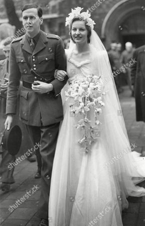 Stock Picture of Marriage of the Hon Deborah Vivien Freeman-mitford (born 1920 and Now Dowager Duchess of Devonshire) to Andrew Cavendish Later the Duke of Devonshire in 1941 the Bride Wore A Dress by Victor Stiebel 1941