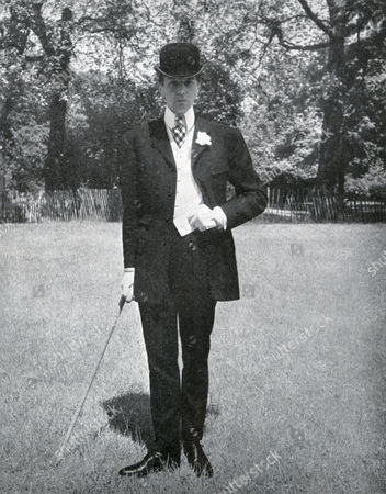 Neil Munro ('bunny') Roger (june 9 1911 in London - April 27 1997 in London) English Couturier War Hero and Dandy Pictured Here Dressed in an Edwardian Style with A Long Jacket with High Four-button Front White Marcella Waistcoat with Step Collar and Narrow Drainpipe Trousers Note Also the Curly Brimmed Bowler and High Stiff Collar 1951