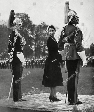 A Young Queen Elizabeth Ii Looks Back Over Her Shoulder As She Waits For A Parade of the Household Cavalry at Home Park Windsor During A Presentation of New Standards She is Flanked by the Colonel of the Royal Horse Guards Maj-gen Sir Richard Howard-vyse and Her Great-uncle Hon Maj-gen the Earl of Athlone 1953