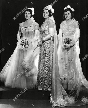 Mrs Joseph Kennedy Wife of H E the United States Ambassador in A Photograph to Mark the Presentation of Two of Her Daughters at the First Court at Buckingham Palace in May 1938 On the Left is Rosemary Kennedy (1918 - 2005) in the Middle Rose Kennedy and On the Right Kathleen 'Kick' Kennedy Kathleen Met Billy Cavendish Heir to the Devonshire Dukedom During the Season and Married Him Becoming Marchioness of Hartington He Was Killed During World War Ii and Kathleen Herself Was Killed in A Plane Crash in 1948 Rosemary Or Rosie Was Deemed Mentally Retarded and Was Subjected to A Frontal Lobotomy at the Age of 23 She Spent Much of Her Life in and out of Asylums 1938