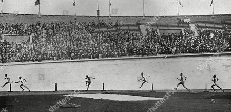The Final of the 400 Metres Hurdles at the 1928 Amsterdam Olympic Games Showing Lord Burghley Silhouetted Against the Concrete Banking of the Stadium Racing His Way to A Gold Medal Victory David George Brownlow Cecil 6th Marquess of Exeter (1905 - 1981) Lord Burghley Was an Athlete Sports Official and Conservative Party Politician As an Athlete Burghley Was A Very Keen Practitioner Who Placed Matchboxes On Hurdles and Practised Knocking Over the Matchboxes with His Lead Foot Without Touching the Hurdle in 1927 His Final Year at Magdalene College Cambridge He Amazed Colleagues by Sprinting Around the Great Court at Trinity College in the Time It Took the College Clock to Toll 12 O'clock Inspiring the Scene in the Film Chariots of Fire (whose Character Lord Andrew Lindsay is Based Upon Burghley) in Which Harold Abrahams Accomplishes the Same Feat Lord Burghley Did not Allow His Name to Be Used in the Film Because of the Inaccurate Historical Depiction in the Movie There Was Never A Race Upon Which Harold Abrahams Beat Lord Burghley in This Feat As the Movie Depicts Burghley is Also Said to Have Set Another Unusual Record by Racing Around the Upper Promenade Deck of the Queen Mary in 57 Seconds Dressed in Everyday Clothes Burghley Later Served As President of the Amateur Athletic Association For 40 Years President of the International Amateur Athletic Federation For 30 Years and As A Member of the International Olympic Committee For 48 Years He Was Also Chairman of the Organising Committee of the 1948 Summer Olympics 1928