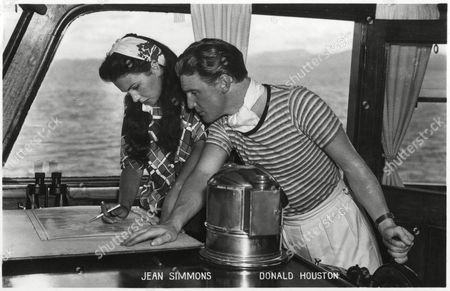 Jean Simmons and Donald Houston On Location For the Film the Blue Lagoon (released 1949) Seen Here Plotting Their Position On the Ship Royal Flight circa 1949