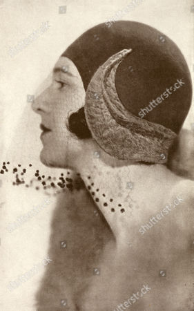 A Hat by Captain Molyneux Using Felt and Curves Breitschwantz Fur at the Sides and Back of This Close-fitting Mode A Fine Full Veil with A Spotted Border Softens the Line and Falls to the Chin 1930