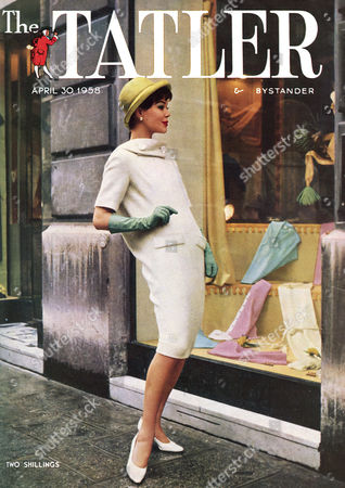 Front Cover of the Tatler Featuring A Photograph of A Chic Young Woman Window Shopping in Paris She Wear A Dress of Fine White Wool with the Curving Line of the Back Continued Over the Shoulders to Button Under the Chin by Pierre Cardin As the Description to the Image Goes 'This is Elegance 1958' 1958