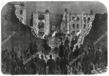 Effects of the Explosion at the House of Detention Clerkenwell Seen From Within the Prison Yard: Police Officers and Firemen Searching the Ruins the Gunpowder Explosion On the Outer Wall of Clerkenwell Prison Was an Attempt to Free Two Fenian Prisoners Richard Burke and Joseph Theobald Casey Who Were Imprisoned There the Explosion Destroyed Several Houses in the Neighbourhood Killed Several People Including As the Illustrated London News Says 'Two Little Children' and Injured Many More 1867