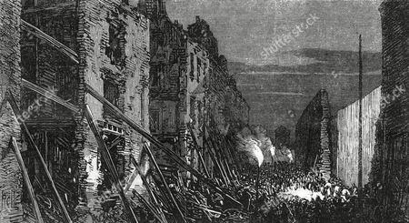 Corporation Lane in East London by Night Showing the Damage Caused to Houses in the Street by the Gunpowder Explosion at Clerkenwell Prison Which Was an Attempt to Free Two Fenian Prisoners Burke and Casey the Explosion Caused Great Damage Injuries and Loss of Life 1867